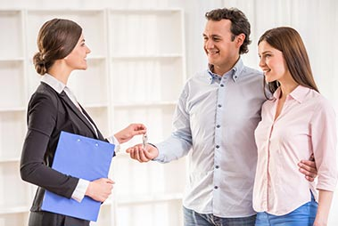 Realtor with Home Buyers